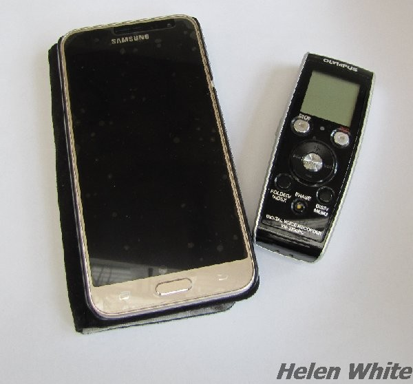 Mobile phone and my old digital dictaphone for recording text.
